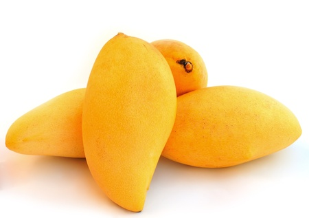 mangoes: Yellow mango isolated on a white background  Stock Photo