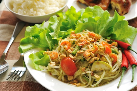 somtum: Somtum Thai food and spicy food on a white dish  Stock Photo