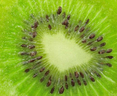 Beautiful slice of fresh juicy kiwi isolated on white background  Stock Photo - 12349998