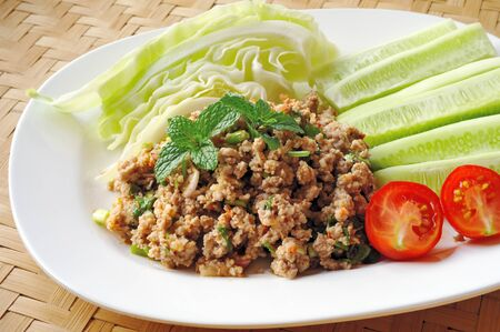 Thai Spicy minced meat salad photo