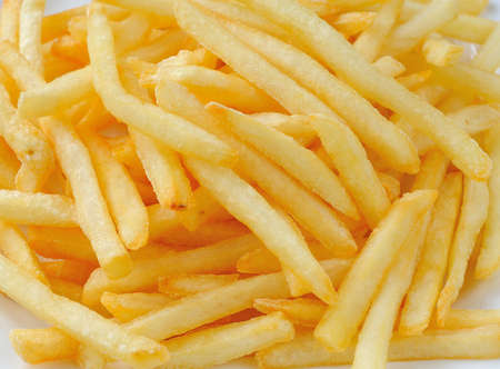 French fries in a white plate photo