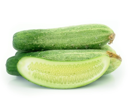 cepelia: Cucumber and slices isolated over white background.  Stock Photo