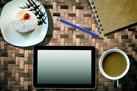 Coffee cup notebook and Tablet Computer  on bamboo  photo