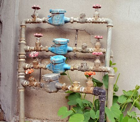 old rusty  water pipe, meter and valve  photo