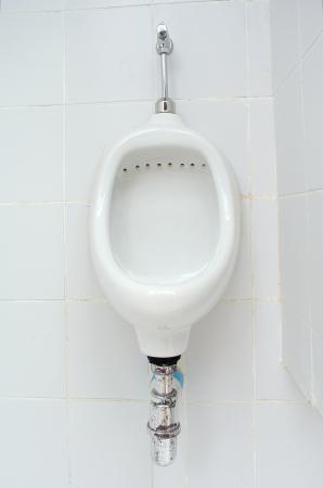 White ceramic sanitary ware in restroom photo