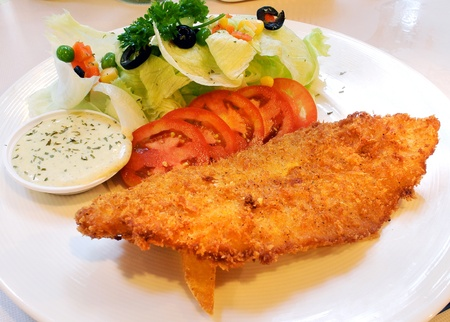 breaded: fried fish and salad