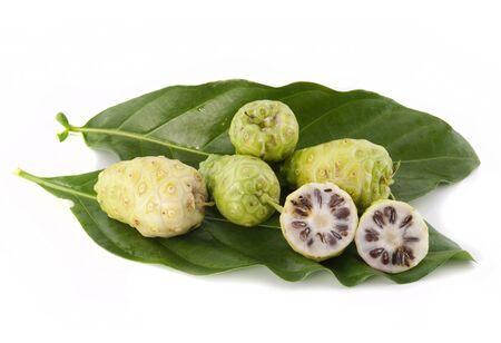 Noni fruits on white isolated background photo