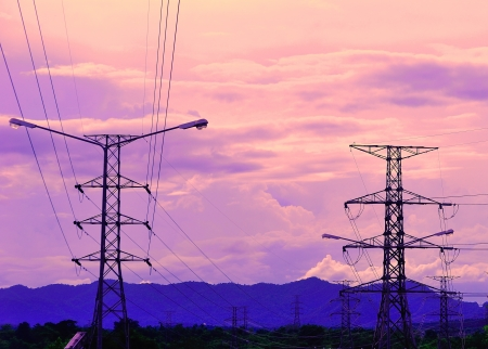Electricity pylons at sunset Stock Photo - 14629747