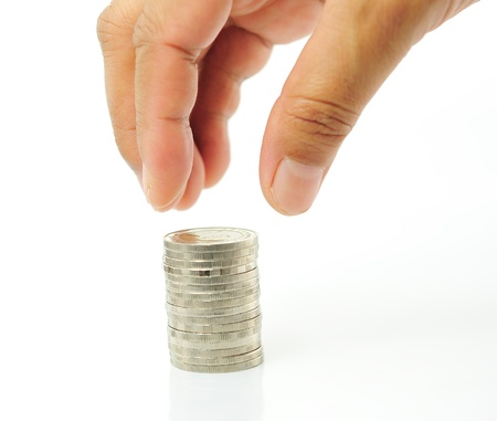 Finger put coin on coin-stack photo