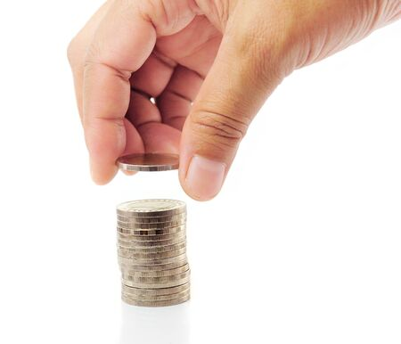 Finger put coin on coin-stack Stock Photo - 14983044