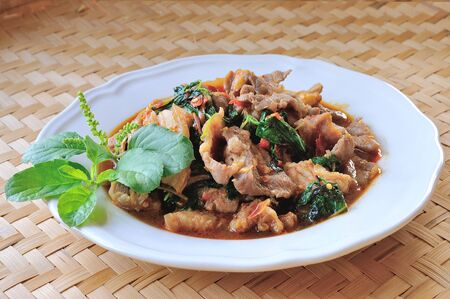 Thai food, Pork,with chili pepper and sweet basil. Stock Photo - 17439968
