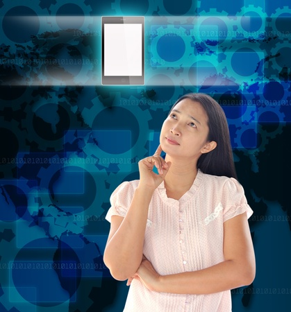 woman looking  mobile phone on world technology background photo