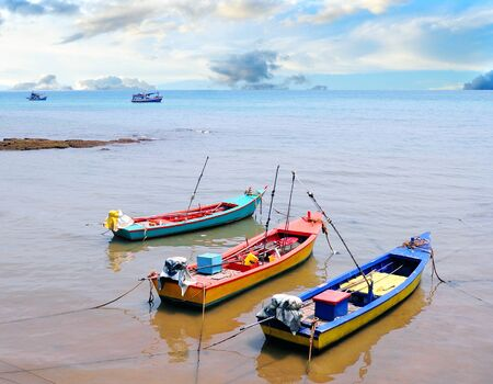 Small fishing boats on the beach photo