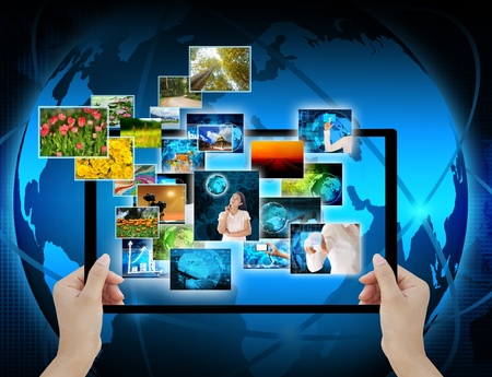 holding Computer display  on technology background photo