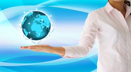 holding a glowing earth globe in his hand photo