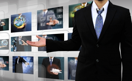 businessman holding Reaching images streaming in hands  Financial and technologies concepts photo