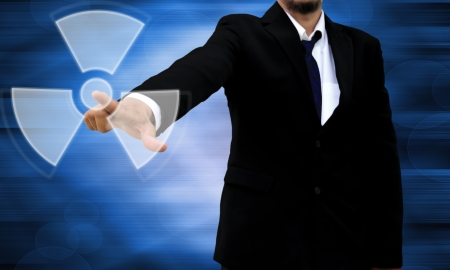 Concept-radiation hazard  Confident modern businessman showing stop gesture Stock Photo - 20243904