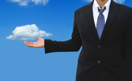Cloud computing concept, young businessman with cloud  photo