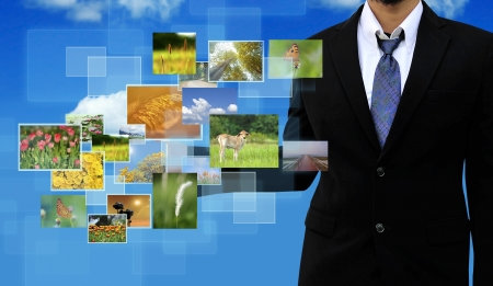 businessman holding Reaching images streaming in hands  Environmental concept photo