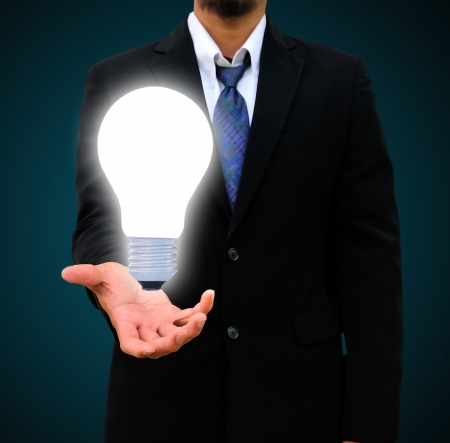 business man holding light bulb photo