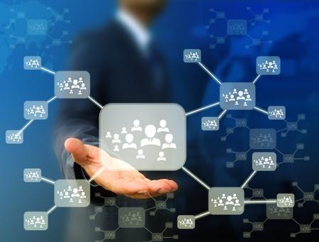 global partnership: Businessman  holding  icon of social network Stock Photo