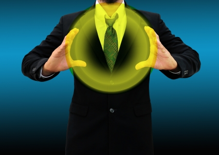 Business man holding  glowing ball photo