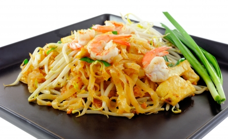 Thai food Pad thai , Stir fry noodles with shrimp on black plate photo