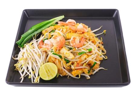 Thai food Pad thai , Stir fry noodles with shrimp on black plate photo