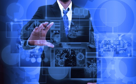 businessman holding Reaching images streaming in hands .Financial and technologies concepts photo