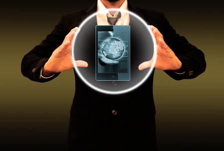 businessman holding mobile phone photo