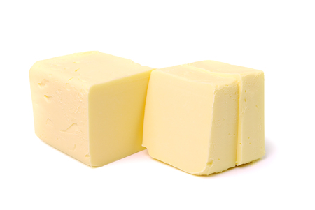 pat: Stick of butter, cut, isolated on white.