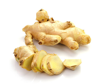 Root ginger isolated on a white studio background photo
