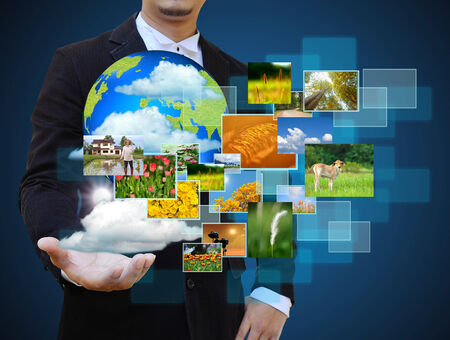 businessman holding green Earth in hands and Reaching images streaming .Environmental concept photo