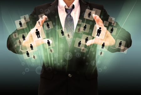 Businessman holding social network photo