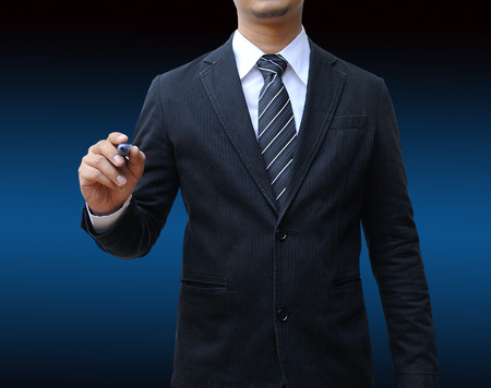 Businessman writing on the screen photo