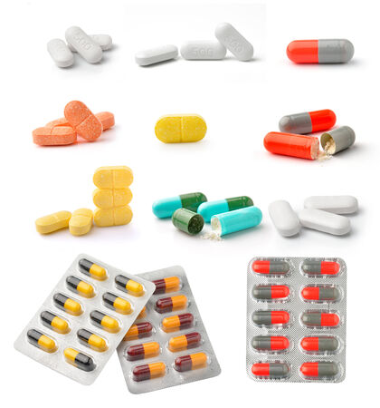 uppers: pills and capsules isolated on white background