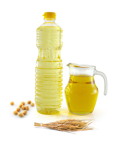 Rice bran oil in bottle glass with seed and soy on white background photo