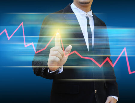 businessman hand pushing a business graph photo