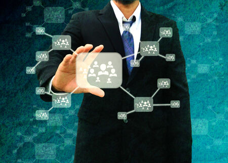 Businessman holding icon of social network in the old paper Texture  photo