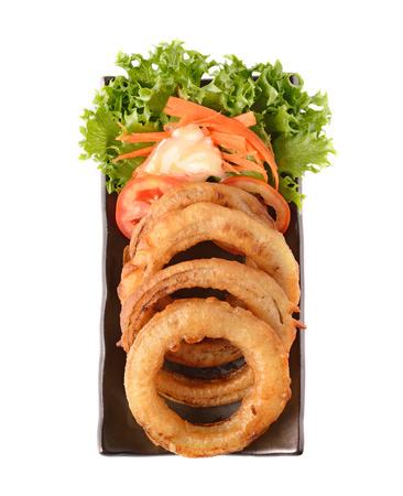onion rings on a plate on white background photo