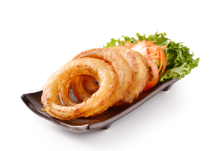 onion rings on a plate on white  photo