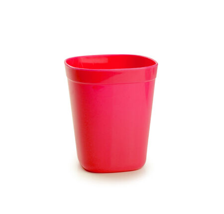 red plastic cup isolated on white background photo