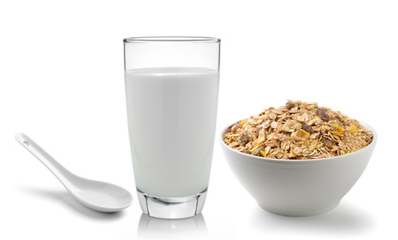 fresh milk in the glass and muesli breakfast placed on white background photo