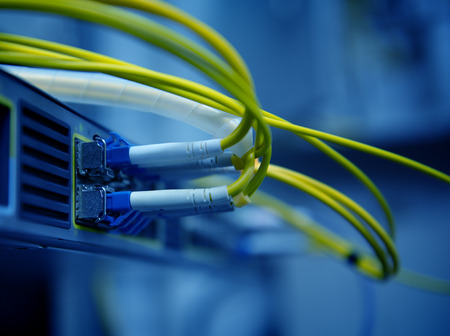 digital data: network optical fiber cables and hub Stock Photo