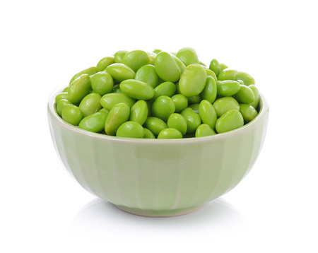 Edamame soy beans in  bowls on white background photo