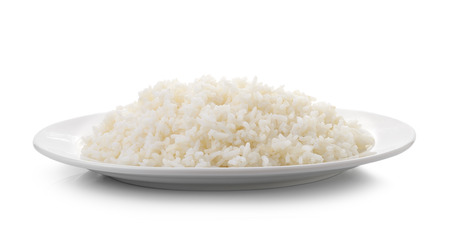 Cooked rice in a white plate on white background