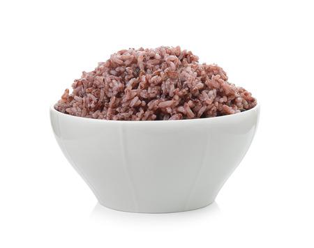 Baya de arroz en un recipiente en el fondo blanco Foto de archivo - 35055397