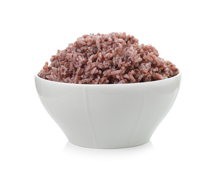 brown backgrounds: rice berry  in bowl on white background