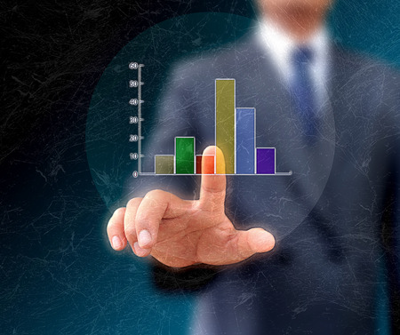 growing business: Graphs on the hands of businessmen. Stock Photo