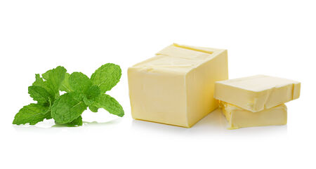 butterfat: mint and Stick of butter isolated on white background